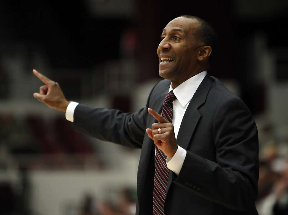 Stanford head coach Johnny Dawkins gestures to his players in the second period. The Stanford men's basketball team played the Fullerton Titans at Maples Pavilion in Stanford, Calif., on Monday, November 12, 2012. Stanford won 81-68 Photo: Carlos Avila Gonzalez, The Chronicle