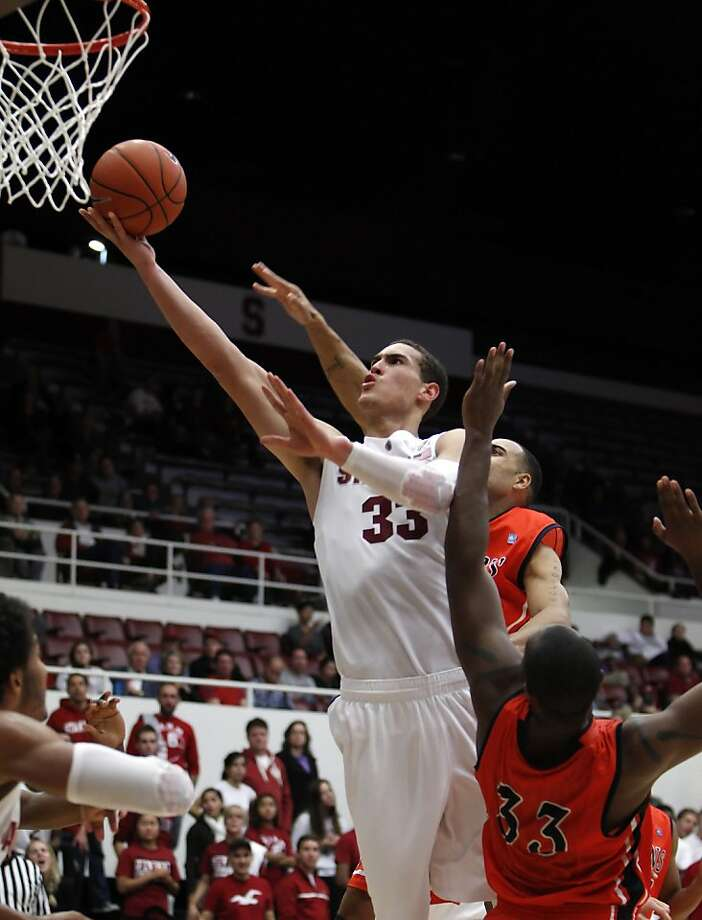 Dwight Powell has become the player Stanford coach Johnny Dawkins envisioned when he recruited the 6-foot-10 forward. Photo: Carlos Avila Gonzalez, The Chronicle