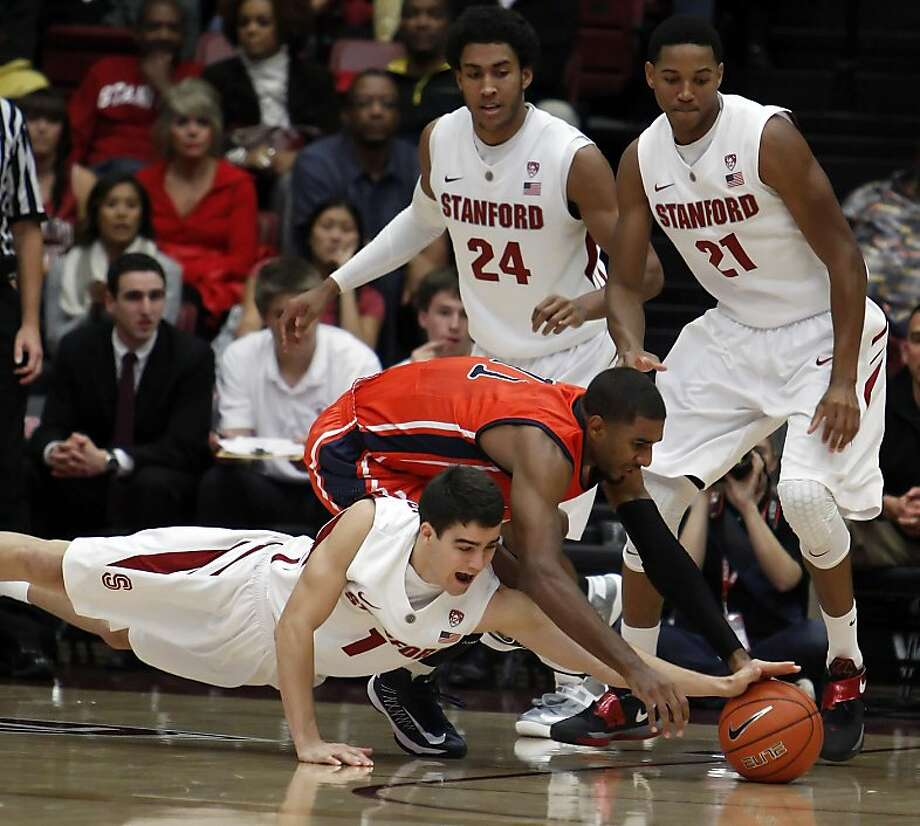 Stanford's Christian Sanders dives for a loose ball as Fullerton's D. J. Seeley tries to get it in the first period. The Stanford men's basketball team played the Fullerton Titans at Maples Pavilion in Stanford, Calif., on Monday, November 12, 2012. Photo: Carlos Avila Gonzalez, The Chronicle