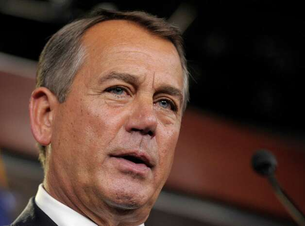 FILE - This Nov. 9, 2012 file photo shows House Speaker John Boehner of Ohio speaking during a news conference on Capitol Hill in Washington. Congress returns Tuesday to a crowded agenda of unfinished business after an election that left the balance of power unchanged but emboldened President Barack Obama and Senate Democrats. Trade with Russia, aid to farmers and a defense policy bill pack a list overshadowed by the urgent need to find a way to avoid tax increases and automatic spending cuts.   (AP Photo/Susan Walsh, File) Photo: Susan Walsh