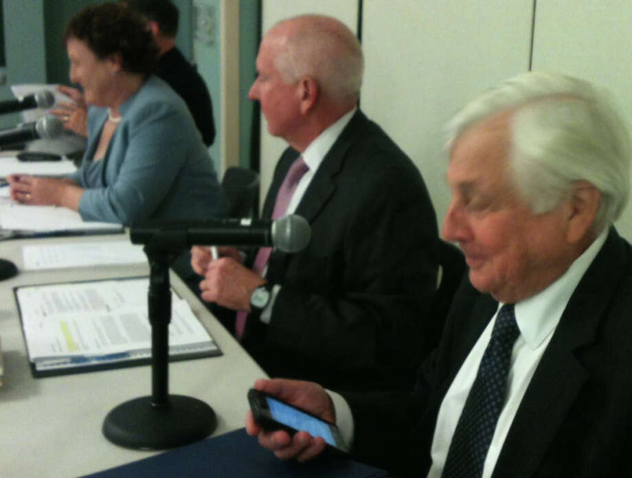Superintendent of Schools Elliott Landon checks his phone during Monday's Board of Education discussion of the proposals to make up for five days Westport schools were forced to close because of Hurricane Sandy.  Westport CT 11/12/12 Photo: Andrew Brophy / Westport News contributed