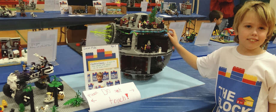 Lucas Pida, 8, of Fairfield, shows off his Skull Truck and Death Star Lego creations at Saturday's Block Party at Fairfield Ludlowe High School.  Fairfield CT 11/10/12 Photo: Mike Lauterborn / Fairfield Citizen contributed