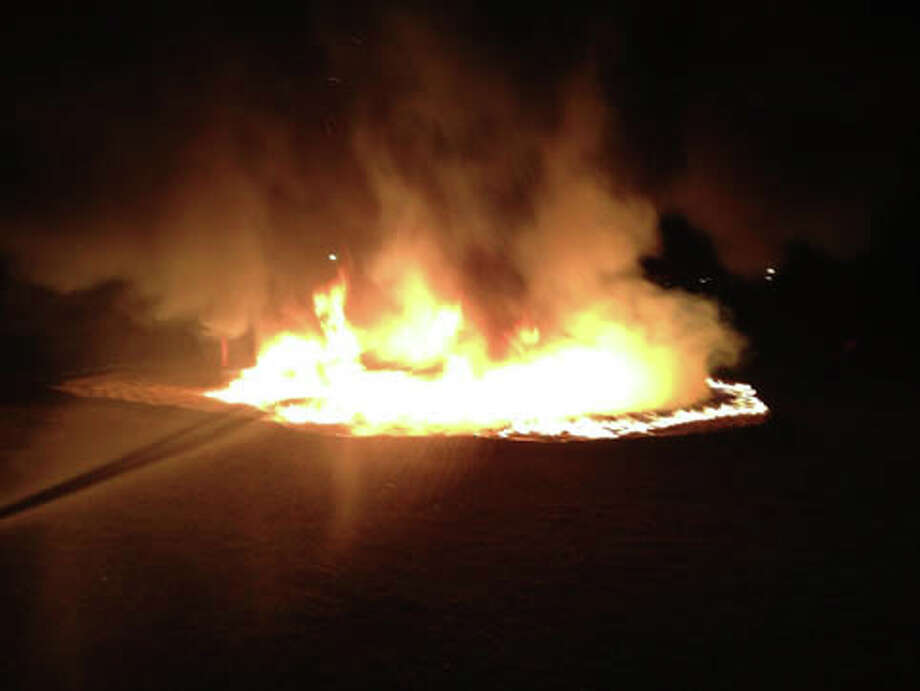 The Montgomery County Fire Marshal's Office and Precinct 5 Constable's Office are investigating the cause of a fire that engulfed playground equipment Monday evening at Smith Elementary School on Hardin Store Road in Magnolia. Photo: Montgomery County Police Reporter