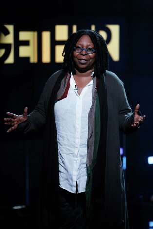 "In this photo provided by NBC, Whoopi Goldberg performs during ""Hurricane Sandy: Coming Together"" Friday, Nov. 2, 2012, in New York. Hosted by Matt Lauer, the event is heavy on stars identified with New Jersey and the New York metropolitan area, which took the brunt of this week's deadly storm. (AP Photo/NBC, Heidi Gutman) Photo: Heidi Gutman / NBC"