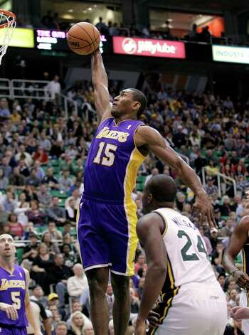 Los Angeles Lakers forward Metta World Peace (15) goes up for a dunk as Utah Jazz forward Paul Millsap (24) watches during the first quarter of an NBA basketball game Wednesday, Nov. 7, 2012, in Salt Lake City. (AP Photo/Rick Bowmer) Photo: Rick Bowmer / AP