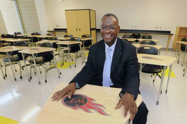 Port Arthur I.S.D. Superintendent Dr. Johnny E. Brown sits at a new desk with the the Port Arthur Titan logo in one of the elementary class rooms of the new Booker T. Washington Elementary Magnet School on Tuesday.   Valentino Mauricio/The Enterprise Photo: Valentino Mauricio / Beaumont