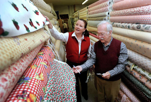 Mary Villa, owner of Silk Road Curtain Trading Company in New Milford, is shown with David Gardner, owner of Chintz-N-Prints in Newtown, where she sometimes shops for her clients, Monday, Nov. 13, 2012. Photo: Carol Kaliff / The News-Times