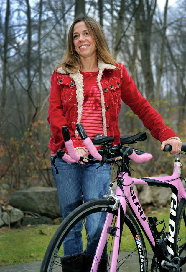 Robin Caruso, 46, won the world duathalon in France in October for para athletes and just finished fourth in the New Zealand triathalon for para athletes.  She is photographed at her Ridgefield home Monday, Nov. 12, 2012. Photo: Carol Kaliff / The News-Times