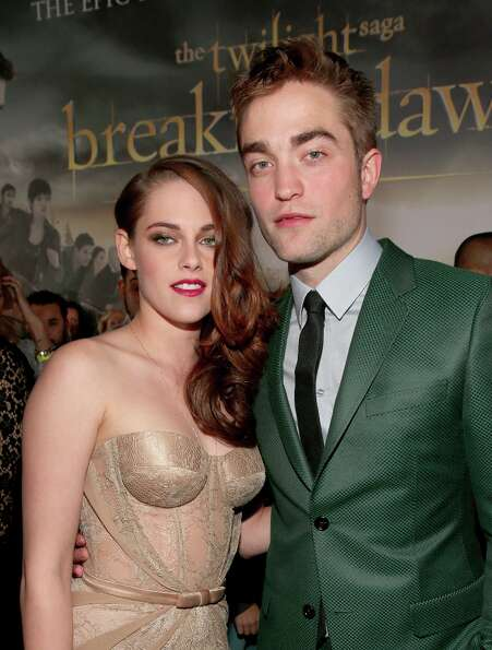Actors Kristen Stewart (L) and Robert Pattinson arrive at the premiere of Summit Entertainment's