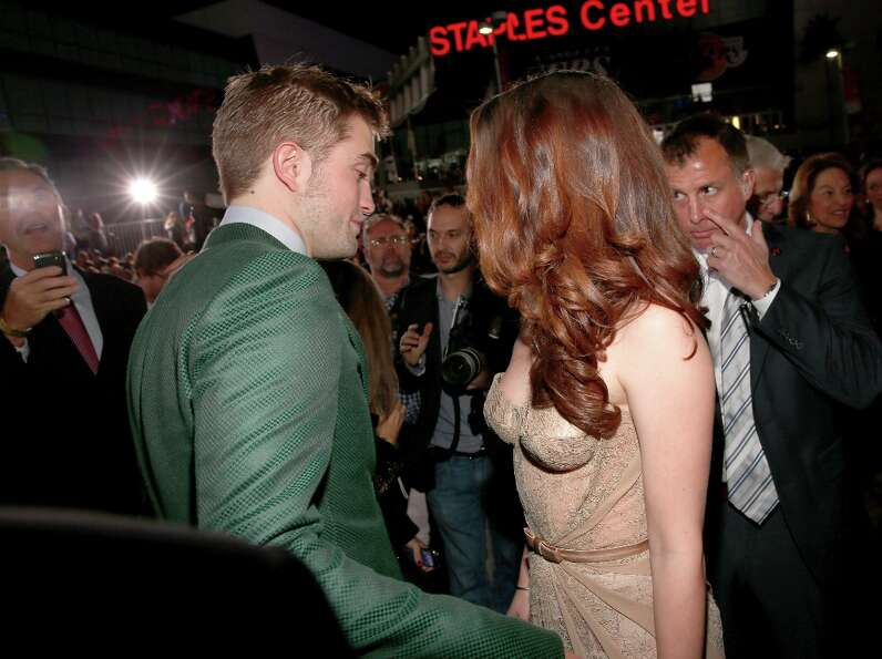 Actors Robert Pattinson (L) and Kristen Stewart arrive at the premiere of Summit Entertainment's