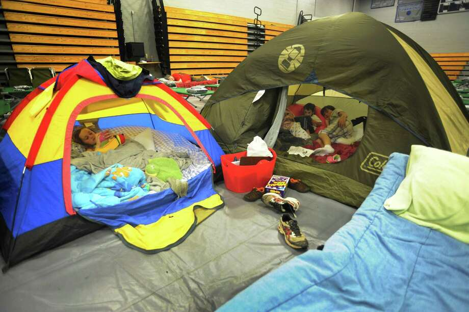 Some families that hunkered down in the town shelter at Fairfield Ludlowe High School pitched tents to make the experience more of an adventure for their kids. Photo: Cathy Zuraw / Connecticut Post