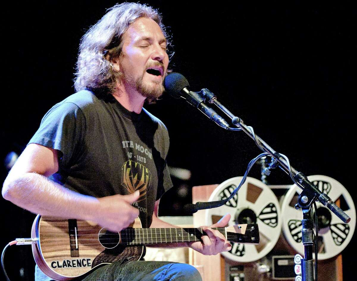 Pearl Jam frontman Eddie Vedder plays his ukulele during his concert at the Royal Theatre Carre in Amsterdam on July 25.