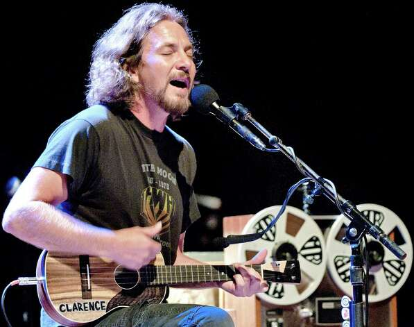 Pearl Jam frontman Eddie Vedder plays his ukulele during his concert at the Royal Theatre Carre in Amsterdam on July 25. Photo: Getty Images