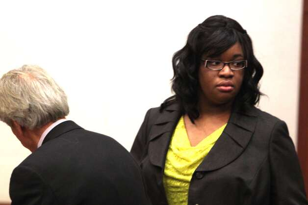 Defendant Jessica Tata with her attorney, Mike DeGeurin, Tuesday, Nov. 13, 2012, in court. Photo: Johnny Hanson / Houston Chronicle