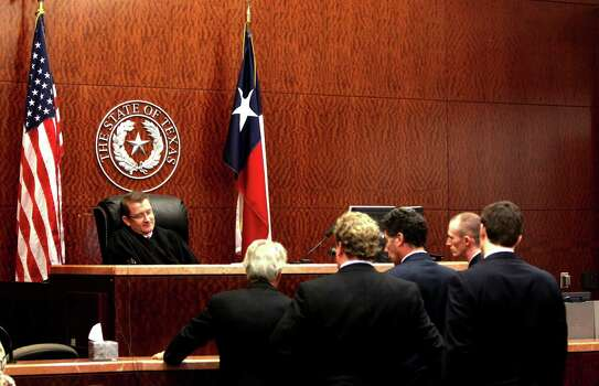 Judge Marc Brown meets with attorneys Tuesday, Nov. 13, 2012, in court. Photo: Johnny Hanson / Houston Chronicle