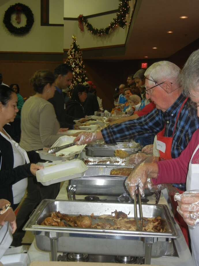 Volunteers served Thanksgiving dinner last year in Katy.Volunteers served Thanksgiving dinner last year in Katy.