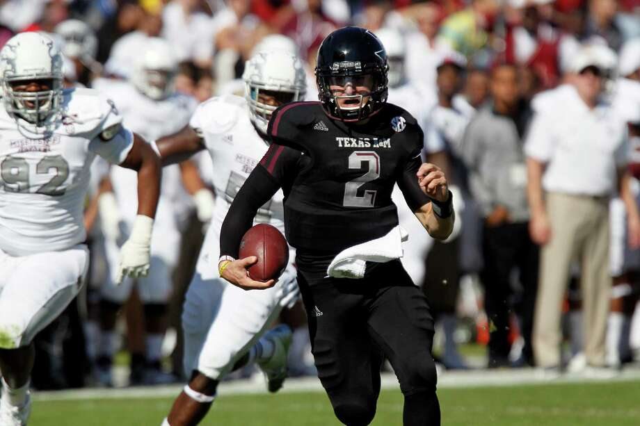 In this Nov. 3, 2012 photograph, Texas A&M quarterback Johnny Manziel (2) runs past Mississippi State defenders in their NCAA college football game in Starkville, Miss. No. 16 Texas A&M won 38-13. (AP Photo/Rogelio V. Solis) Photo: Rogelio V. Solis, Associated Press / AP