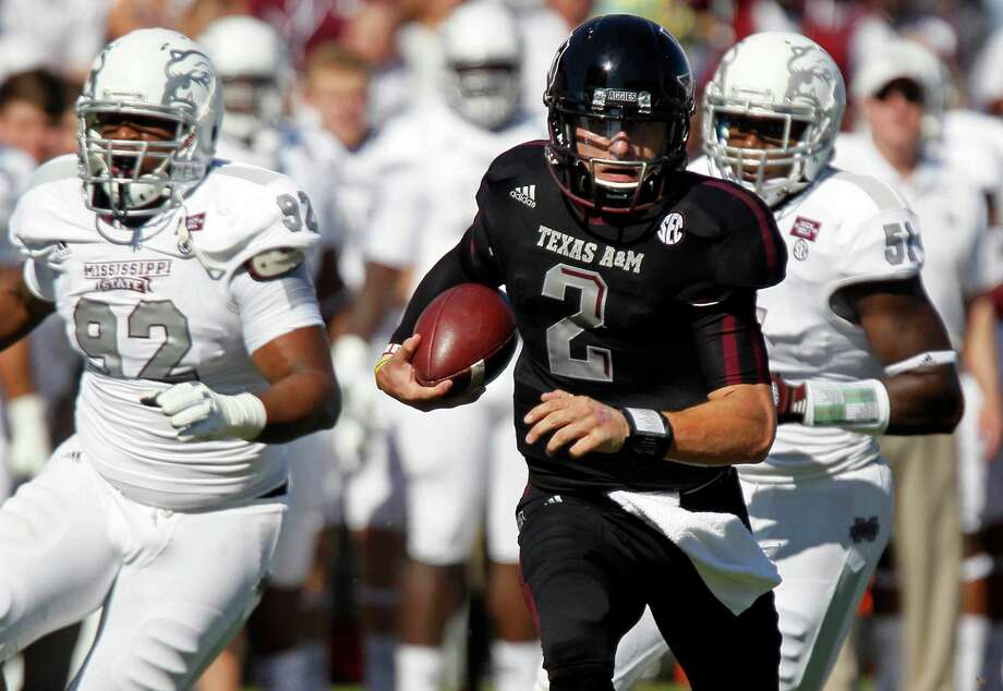 Texas A&M quarterback Johnny Manziel (2) runs past Mississippi State defensive lineman Kaleb Eulls (92) and other defenders for a touchdown in the second quarter of an NCAA college football game in Starkville, Miss., Saturday, Nov. 3, 2012.  (AP Photo/Rogelio V. Solis) Photo: Rogelio V. Solis, Associated Press / AP