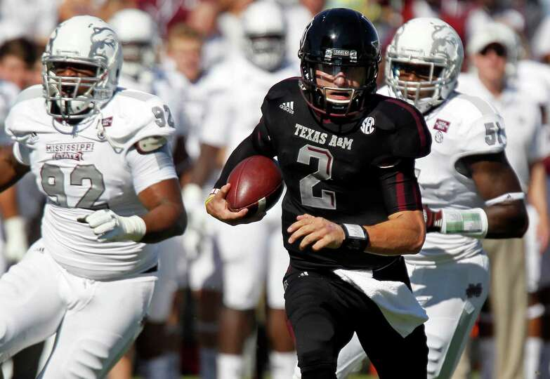 Texas A&M quarterback Johnny Manziel (2) runs past Mississippi State defensive lineman Kaleb Eulls (