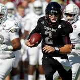 Texas A&M quarterback Johnny Manziel (2) runs past Mississippi State defensive lineman Kaleb Eulls (92) and other defenders for a touchdown in the second quarter of an NCAA college football game in Starkville, Miss., Saturday, Nov. 3, 2012.  (AP Photo/Rogelio V. Solis)