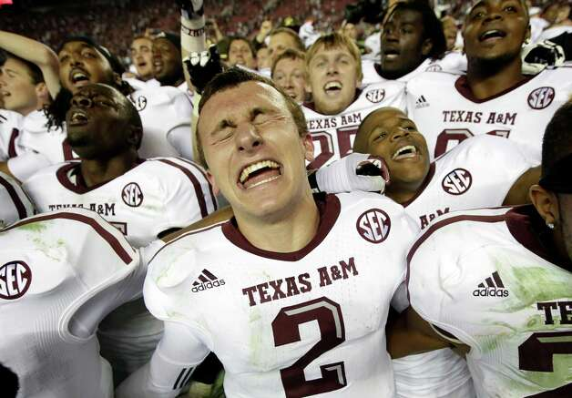 Texas A&M quarterback Johnny Manziel (2) reacts at the end of a 29-24 win over Alabama in an NCAA college football game against Alabama at Bryant-Denny Stadium in Tuscaloosa, Ala., Saturday, Nov. 10, 2012.  (AP Photo/Dave Martin) Photo: Dave Martin, Associated Press / AP