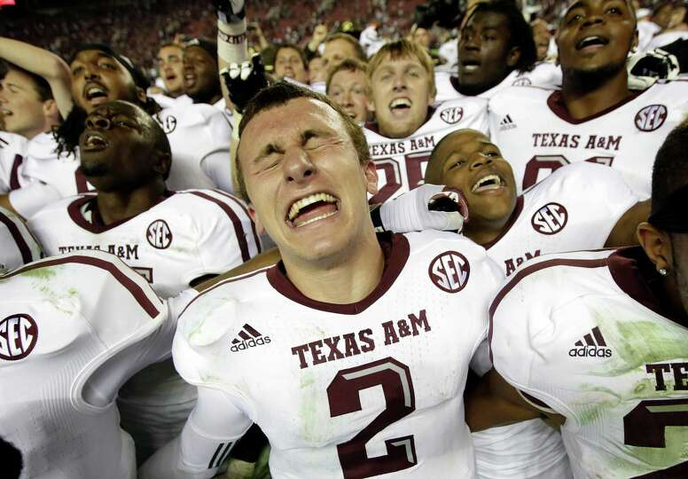 Texas A&M quarterback Johnny Manziel (2) reacts at the end of a 29-24 win over Alabama in an NCAA co