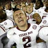 Texas A&M quarterback Johnny Manziel (2) reacts at the end of a 29-24 win over Alabama in an NCAA college football game against Alabama at Bryant-Denny Stadium in Tuscaloosa, Ala., Saturday, Nov. 10, 2012.  (AP Photo/Dave Martin)