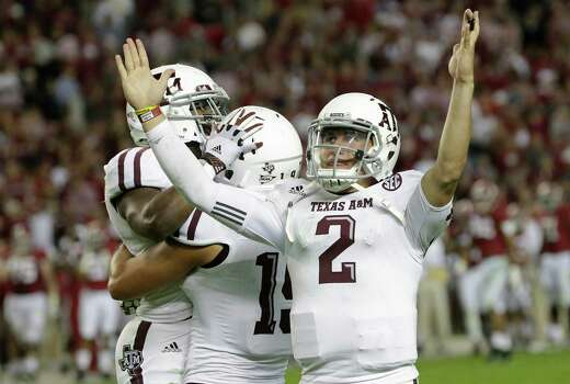 Texas A&M quarterback Johnny Manziel (2) reacts as he and teammates celebrate a win over top ranked Alabama during an NCAA college football game at Bryant-Denny Stadium in Tuscaloosa, Ala., Saturday, Nov. 10, 2012. Texas A&M won 29-24. (AP Photo/Dave Martin) Photo: Dave Martin, Associated Press / AP