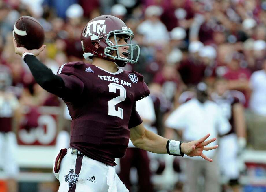Arkansas quarterback Johnny Manziel throws a pass during the third quarter of an NCAA college football game against the Arkansas Saturday, Sept. 29, 2012, in College Station, Texas. (AP Photo/Pat Sullivan) Photo: Pat Sullivan, Associated Press / AP