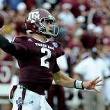 Arkansas quarterback Johnny Manziel throws a pass during the third quarter of an NCAA college football game against the Arkansas Saturday, Sept. 29, 2012, in College Station, Texas. (AP Photo/Pat Sullivan)