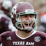 COLLEGE STATION, TX - SEPTEMBER 29:  Johnny Manziel #2 of the Texas A&M Aggies celebrates a touchdown against the Arkansas Razorbacks at Kyle Field on September 29, 2012 in College Station, Texas.