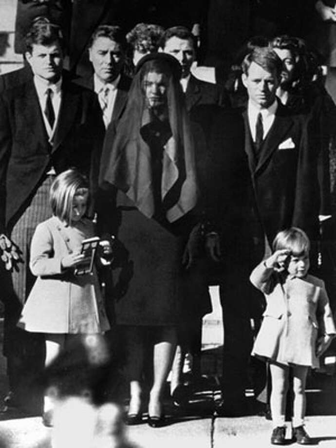 1963 JFK's Funeral (1963) The endlessly reproduced photo of stoic widow Jackie Kennedy with her young children, Caroline and JFK Jr., is now a classic image of maternal strength and grace.   The Breast Pump (1960s) Even after mom goes back to work, babies can still have breast milk. and now dads can help feed the baby, too!  Reprinted with Permission of Hearst Communications, Inc. Originally Published: The Best Mom Moments of All Time Photo: Newscom / Newscom