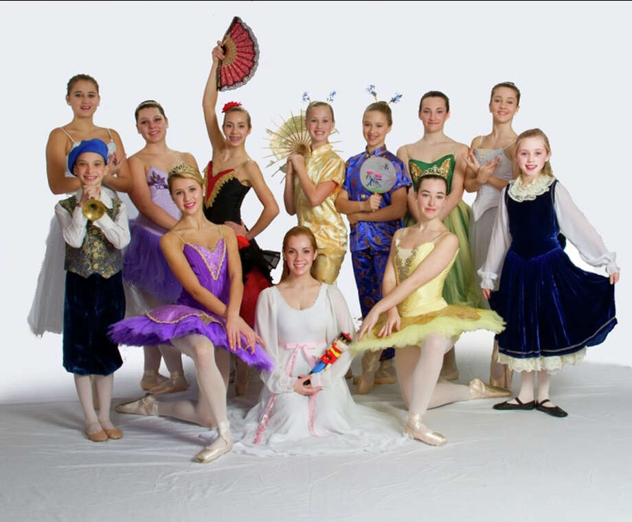 "Among the New Canaan residents appearing in ""The Nutcracker"" on Nov. 30 and Dec. 1 and 2 are, standing from left, Ava Edmunds, Talya Oral, Lauren Kranzlin, Kristin Davis, Hailey Daniel, Maria Fagerstal, Elizabeth Bochicchio, Sarah Wilson and Caroline Meyer. Kneeling or sitting from left, Finley Walker, Emilie Kushner and Laura McLaughlin. Photo: Contributed"