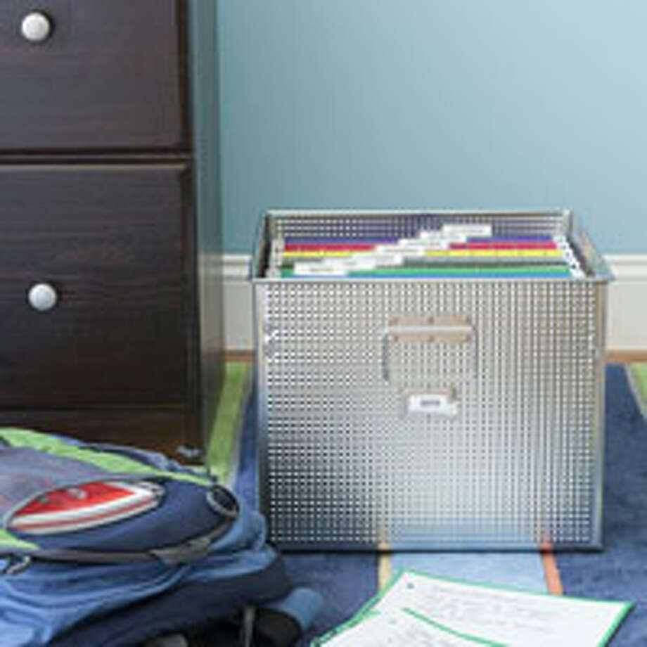 "Filed Away Create a ""home file,"" either a file box or a cabinet drawer, with a slot for each subject; color-code the tabs to match up with any folders, etc., used for each class. Not only does this system give kids a place to unload weekly papers, but it also helps them organize reference materials (e.g., that periodic table of the elements) as the semester changes. Also important: creating a study-friendly spot that's well-lit and has a comfy seat and good-size work surface — it can be a bedroom desk or the kitchen table. Turn off the wireless router or unplug the TV, if needed, to keep distractions at bay.  Reprinted with Permission of Hearst Communications, Inc. Originally Published: 5 Secrets of Super-Organized Parents Photo: Andrew McCaul"