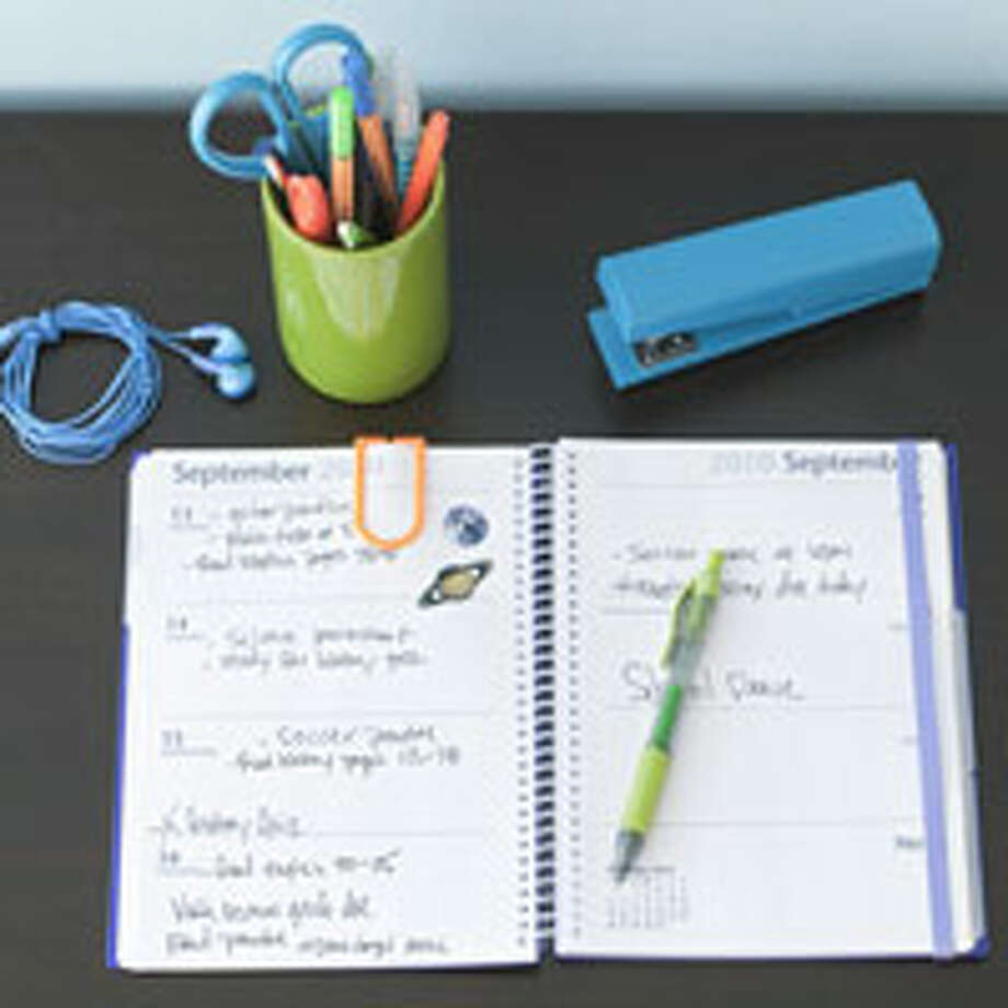 "Plan Ahead Experts recommend week-at-a-glance planners to teach older children time management. But it doesn't  help anyone if your son's ""soccer game at 6 p.m."" never makes it onto the radar of his driver (i.e., you). Transfer items to the family calendar — or ask the kids to do so — once a week and as things come up. Don't skip this tip: Before starting homework, have kids check their planner, assess their work, and unpack accordingly. As each to-do is done, it goes back into the bag — so nothing gets ""forgotten"" at home.  Reprinted with Permission of Hearst Communications, Inc. Originally Published: 5 Secrets of Super-Organized Parents Photo: Andrew McCaul"