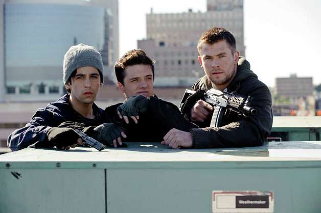 "Josh Peck, from left, Chris  Hemsworth and Josh Hutcherson star in the 2012 remake of ""Red Dawn."" Photo: RON PHILLIPS, New York Times / FILMDISTRICT"