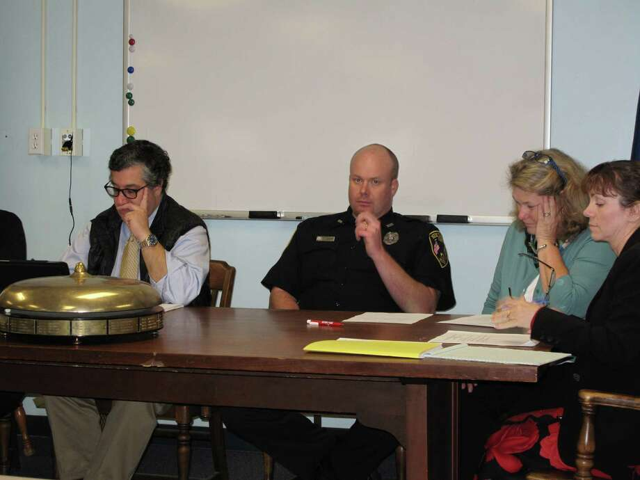 From left: First Selectman Rob Mallozzi, Police representative Mike O'Sullivan, Board of Finance member Mary Cody, and town CFO Dawn Norton, at the Pension Committee meeting Tuesday, Nov. 13, 2012, at the fire house. Photo: Tyler Woods