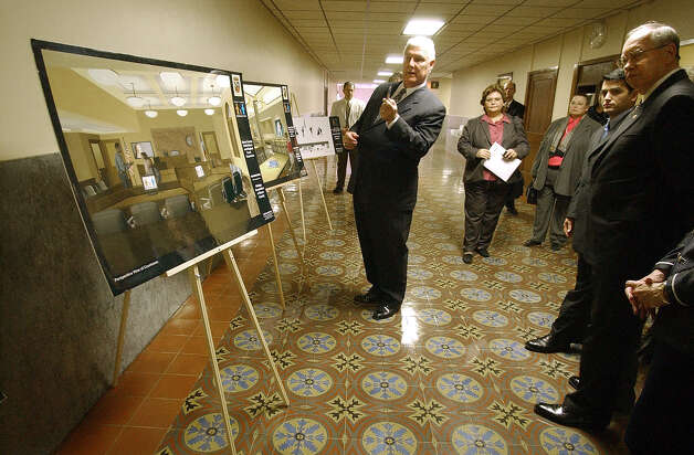 METRO - Bexar County Judge John Specia shows images of the Bexar County Child Abuse and Neglect Court expansion plans to dignitaries during a tour at the court house on Friday, Apr. 4, 2003. The tour was given prior to a re-dedication ceremony. (Kin Man Hui/staff) Photo: KIN MAN HUI, SAN ANTONIO EXPRESS-NEWS / SAN ANTONIO EXPRESS-NEWS