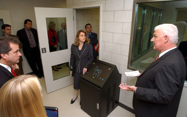Judge John Specia, right, shows the holding cells during a tour of the new Family Court in the Bexar County Courthouse to state legislators and elected officials, Wednesday, Dec. 8, 2004. photo Bob OWen Photo: BOB OWEN, SAN ANTONIO EXPRESS-NEWS / SAN ANTONIO EXPRESS-NEWS