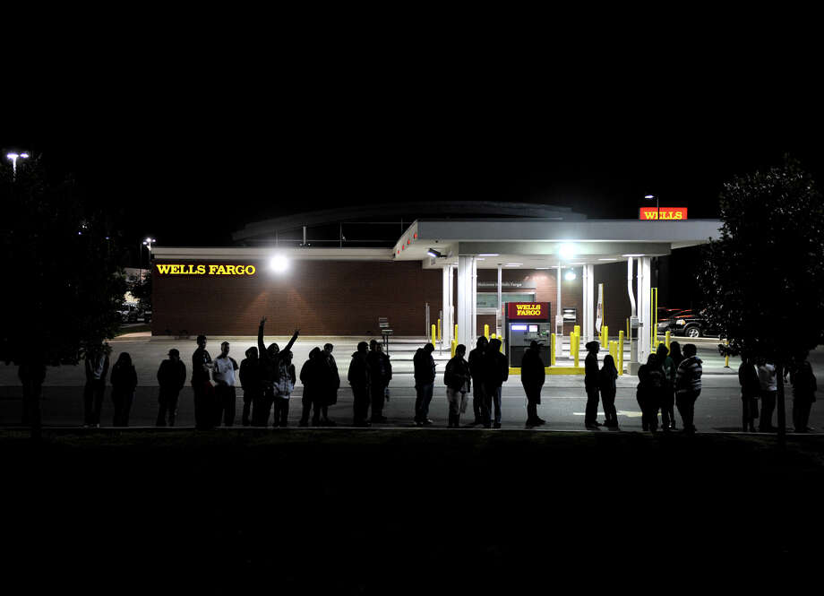 The line stretched around the building as over 300 people waited in line to get their copy of Call of Duty Black Ops 2 shortly before midnight Monday. Photo: Robin Jerstad/For The Express-Ne