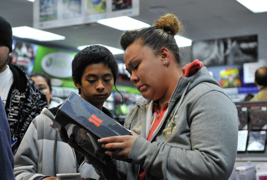 GameStop plans to hire 17,000 workers across the country to prepare for the holiday season. The upcoming launch of the Xbox One and PlayStation 4 will also require stores to be more than fully staffed.Source: GameStop Photo: Robin Jerstad/For The Express-Ne