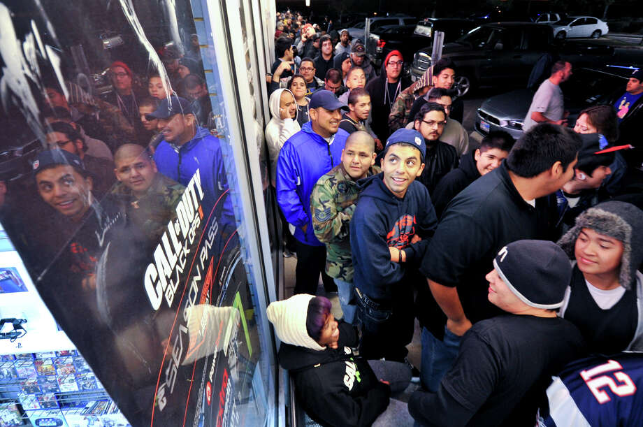 Over 300 people lined up at the GameStop near 410 and Military Drive Monday night for the midnight release of Call of Duty Black Ops2. Photo: Robin Jerstad/For The Express-Ne