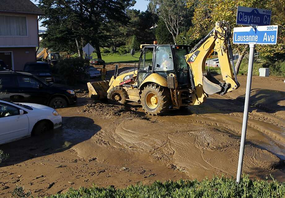 Public works and water crews clean up on Lausanne Avenue and Clayton Court after a river of mud rolled through a neighborhood following a water line break from a hilltop reservoir in Daly City, Calif. on Tuesday, Nov. 13, 2012. Photo: Paul Chinn, The Chronicle