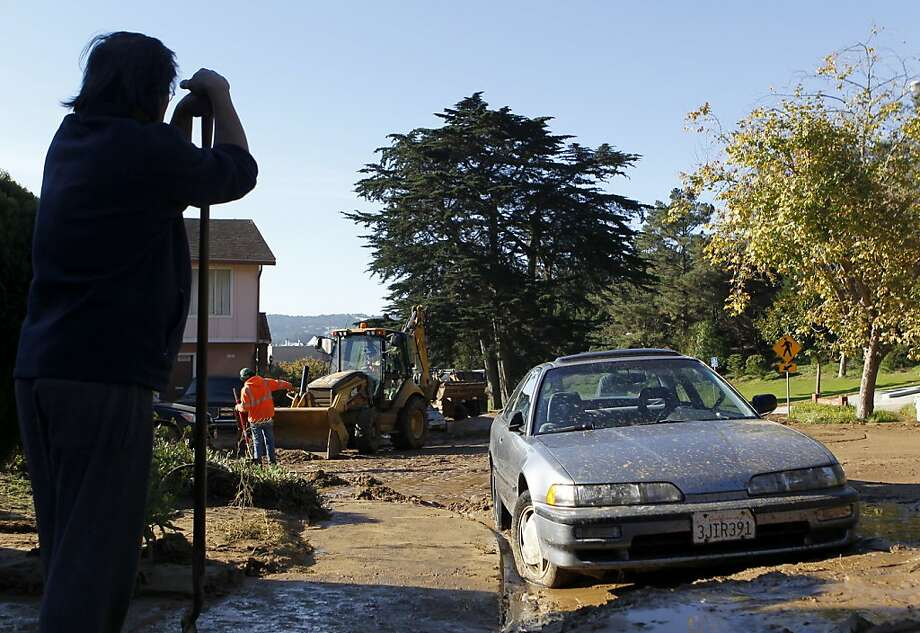 Resident Gualter Fontanilla waits for help from city crews to free his car from thick mud after a mudslide rolled through his neighborhood following a water line break from a hilltop reservoir in Daly City, Calif. on Tuesday, Nov. 13, 2012. Photo: Paul Chinn, The Chronicle