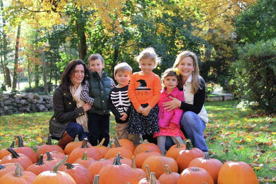 The Young Women's League of New Canaan and Staying Put in New Canaan have again teamed up to serve residents. YWL members, many with small children in tow, donated and delivered more than 50 pumpkins to Staying Put members.This annual activity brings some of the youngest and most senior members of the town together.  The YWL and Staying Put will meet up again in December at Waveny House to decorate Christmas wreaths that Staying Put members will take home to enjoy. From left, Elizabeth Boccaccio, Max Boccaccio, Colin Sharma, Sadie Sharma, Sofia Boccaccio and Sara Sharma. Photo: Contributed
