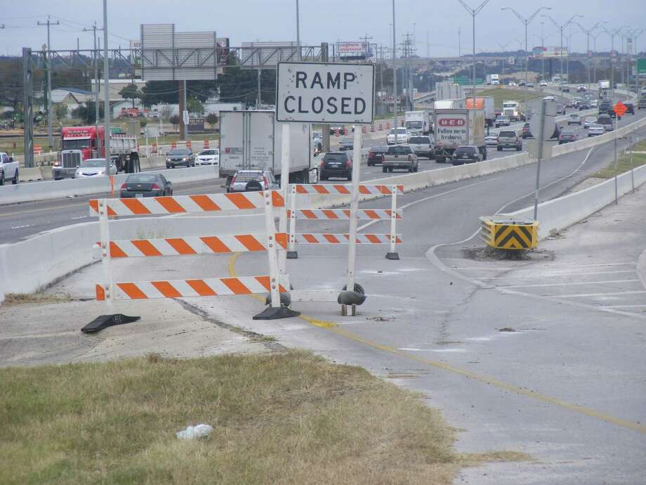 Concrete and wooden barricades bar motorists from using the Interstate 35 South entrance ramp from Schertz Parkway. Ramp closures along I-35 will be in place through January. Photo: David DeKunder / NE Herald