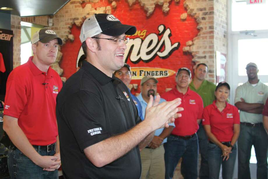 General Manager Bruce Pohlmeier claps with enthusiasm at the opening of Raising Cane's Chicken Fingers on Bandera Road in Leon Valley. The chain, begun in Baton Rouge, La., is opening several restaurants in the Greater San Antonio area, the Leon Valley location being the first. Photo: Lauri Gray Eaton / Northwest Wee