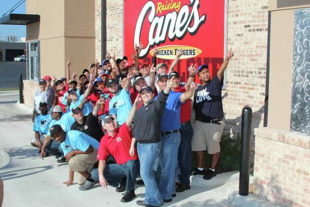 "Employees gather outside the newly opened Raising Cane's in Leon Valley on Nov. 8 to rally around the restaurant's ""one love,"" chicken fingers. Photo: Lauri Gray Eaton / Northwest Wee"