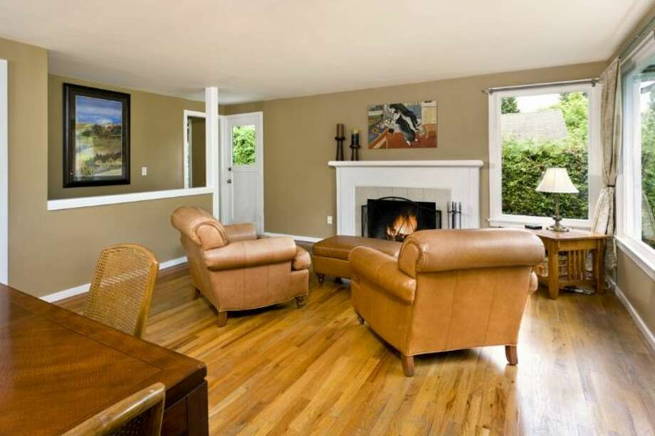 Living room of 7532 23rd Ave. N.E. The 1,720-square-foot house, built in 1950, has two bedrooms, one bathroom, a lower-level rec room and a back deck on a 6,196-square-foot lot. It's listed for $424,950. Photo: Courtesy Jane Johnson/Windermere Real Estate