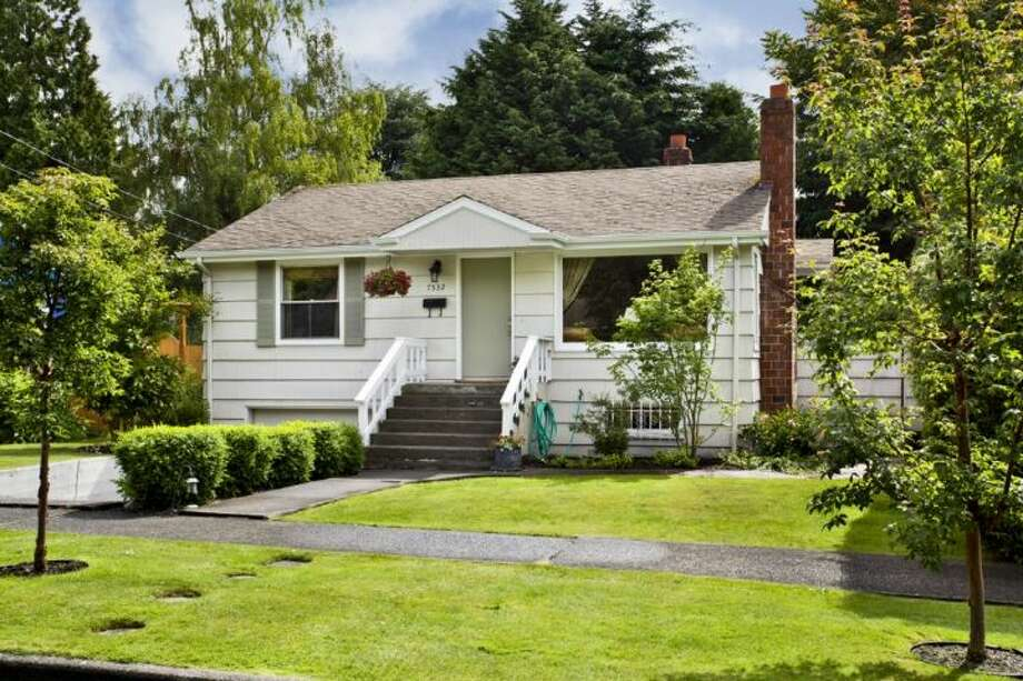 For a little less, $424,950, you could get 7532 23rd Ave. N.E. The 1,720-square-foot house, built in 1950, has two bedrooms, one bathroom, a lower-level rec room and a back deck on a 6,196-square-foot lot. Photo: Courtesy Jane Johnson/Windermere Real Estate